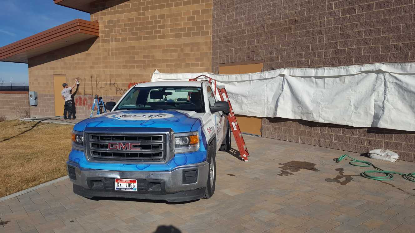 elite restoration truck in front of portneuf wellness complex in pocatello idaho during a graffiti restoration job