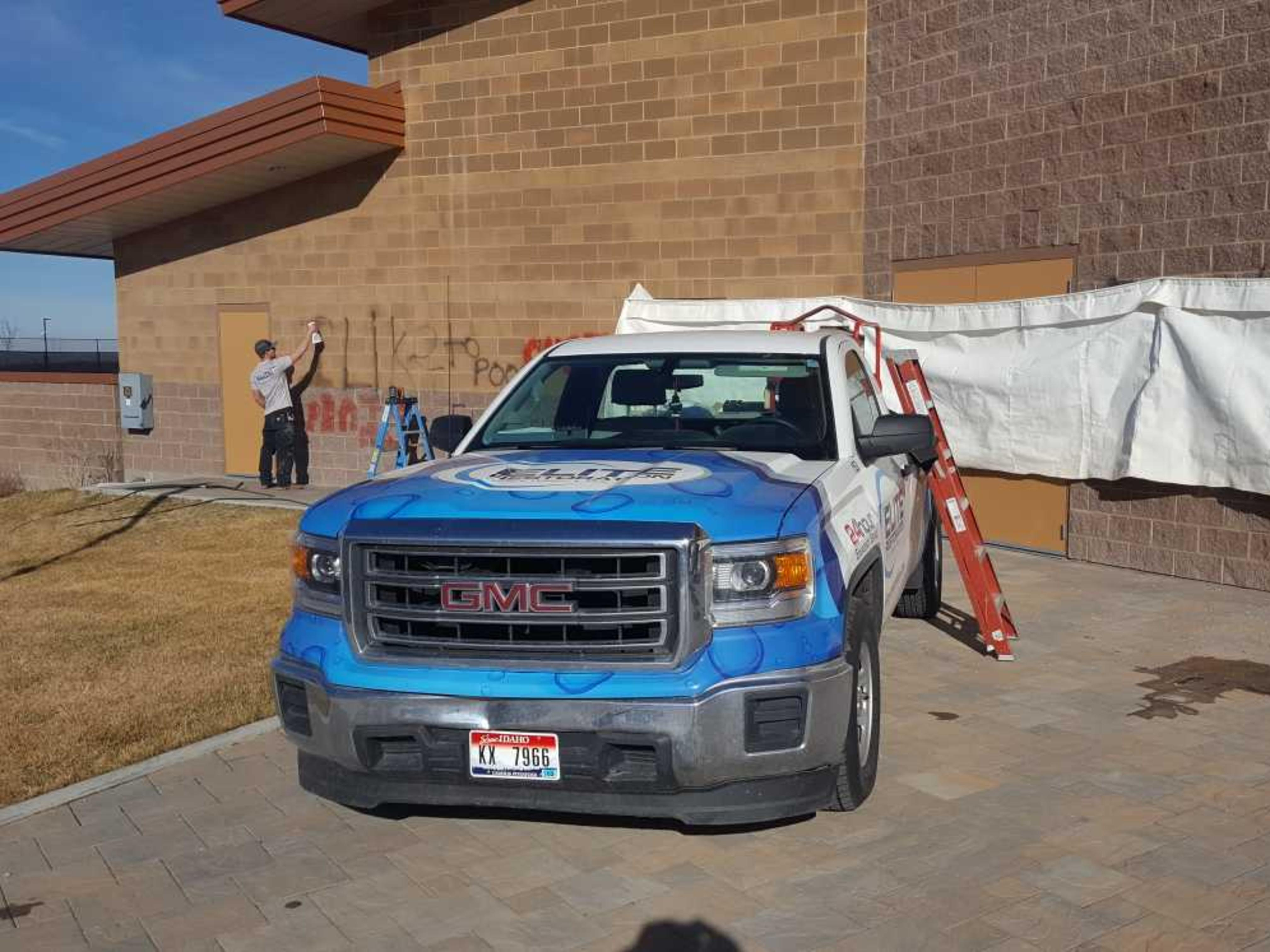 Image: Elite Restoration truck in the front of the Portneuf Wellness Complex as restoration techs remove graffiti.