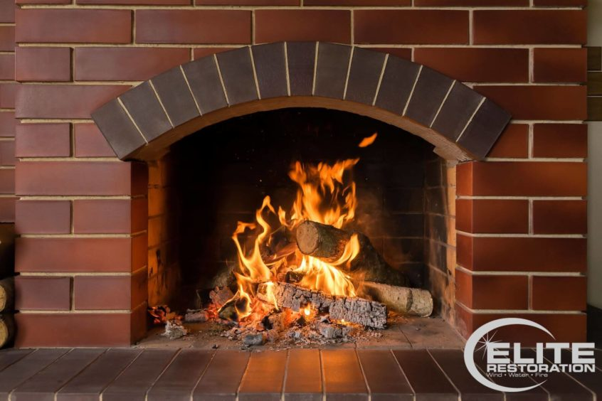 brick-fireplace-with-lit-fire-burning-inside