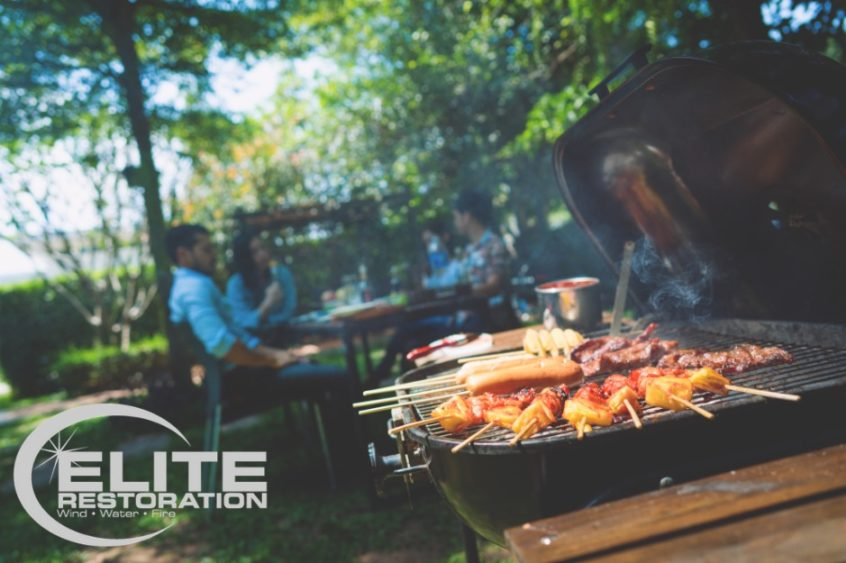 family-using-barbeque-grill-outdoors