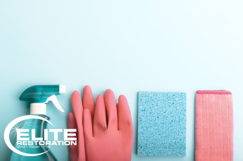 blue-and-pink-cleaning-supplies-spray-bottle-gloves-sponge-towel
